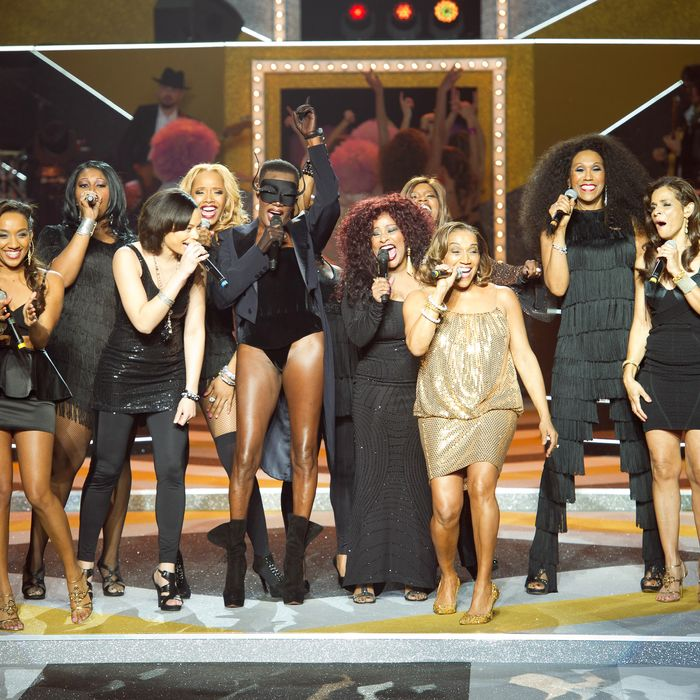 Singers perform on stage during Etam Spring / Summer 2012 Collection Launch at Les Beaux-Arts de Paris on January 23, 2012 in Paris, France.