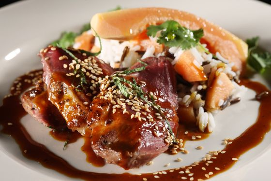 Steak de canard with sweet and sour spices and wild and basmati rice.