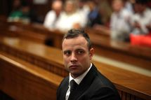 Oscar Pistorius at the Pretoria High Court on March 5, 2014, in Pretoria, South Africa. Oscar Pistorius, stands accused of the murder of his girlfriend, Reeva Steenkamp, on February 14, 2014. This is Pistorius' official trial, the result of which will determine the paralympian athlete's fate.