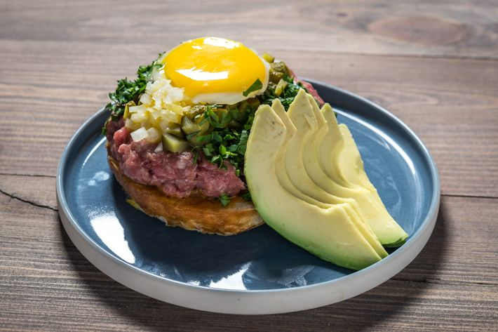 Beef-tartare burger with avocado, scallions, capers, and Savora mustard.