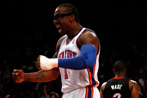 NEW YORK, NY - MAY 06:  Amare Stoudemire #1 of the New York Knicks reacts after he dunked in the first half against the Miami Heat in Game Four of the Eastern Conference Quarterfinals in the 2012 NBA Playoffs on May 6, 2012 at Madison Square Garden in New York City. NOTE TO USER: User expressly acknowledges and agrees that, by downloading and or using this photograph, User is consenting to the terms and conditions of the Getty Images License Agreement  (Photo by Jeff Zelevansky/Getty Images)