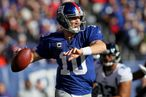 EAST RUTHERFORD, NJ - NOVEMBER 28: Eli Manning #10 of the New York Giants throws a pass against the Jacksonville Jaguars at New Meadowlands Stadium on November 28, 2010 in East Rutherford, New Jersey.  (Photo by Chris McGrath/Getty Images) *** Local Caption *** Eli Manning