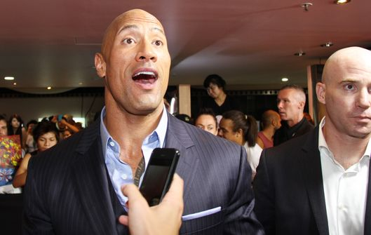 Dwayne Johnson (The Rock) arrives in a Humvee for the red carpet premiere of 'GI Joe: Retaliation,' which is an upcoming 2013 American science fiction action film directed by Jon M. Chu. The premiere was held at the Cinemas on George Street in Sydney, Australia.