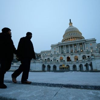 Pedestrians walk past the U.S. Capitol building prior to U.S. President Barack Obama's State of the Union address in front of the U.S. Congress, on Capitol Hill in Washington January 28, 2014.