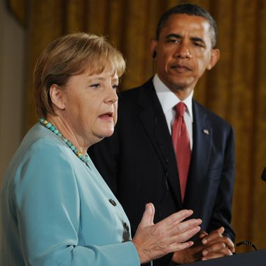 US President Barack Obama and German Chancellor Angela Merkel hold a joint press conference in the East Room of the White House in Washington, DC, June 7, 2011, as part of an official visit. AFP PHOTO / Saul LOEB (Photo credit should read SAUL LOEB/AFP/Getty Images)