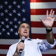"""WESTERVILLE, OH - SEPTEMBER 26:  Republican U.S. presidential candidate Mitt Romney speaks during a campaign rally at Westerville South High School September 26, 2012 in Westerville, Ohio. Romney continued his two-day """"Romney Plan For A Stronger Middle Class"""" bus tour in the state of Ohio.  (Photo by Alex Wong/Getty Images)"""