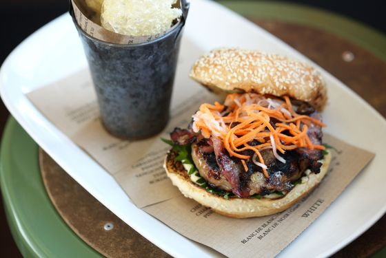 Bun cha burger: grilled pork patty, bacon, perilla, cucumbers, crispy pig skins.