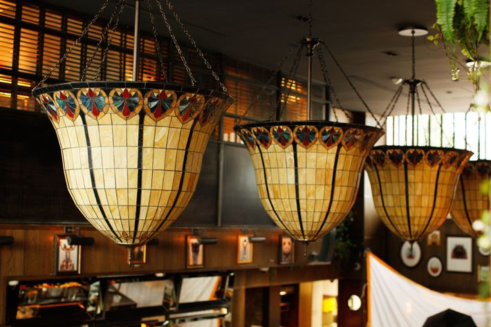 Carroll and Panella incorporated fern-bar design cues like Tiffany lamps and boxed-out mirrors.