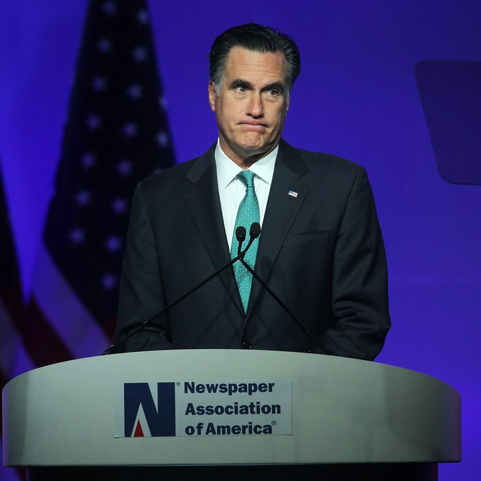 WASHINGTON, DC - APRIL 04: Republican presidential candidate and former Massachusetts Governor Mitt Romney addresses a luncheon hosted by Newspaper Association of America and American Society of News Editors during the MediaXchange conference April 4, 2012 in Washington, DC. The winning of the primaries in Wisconsin, Maryland and the District of Columbia have put Romney into an almost certain position to become the GOP presidential nominee for the general election. (Photo by Alex Wong/Getty Images)