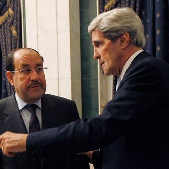 BAGHDAD, IRAQ - MARCH 24: U.S. Secretary of State John Kerry (R) meets with Iraq's Prime Minister Nouri al-Maliki on March 24, 2013 in Baghdad. According to a U.S. official, Kerry will urge Prime Minister Nuri al-Maliki to make sure Iranian flights over Iraq do not carry arms and fighters to Syria. (Photo by Jason Reed - Pool/Getty Images)