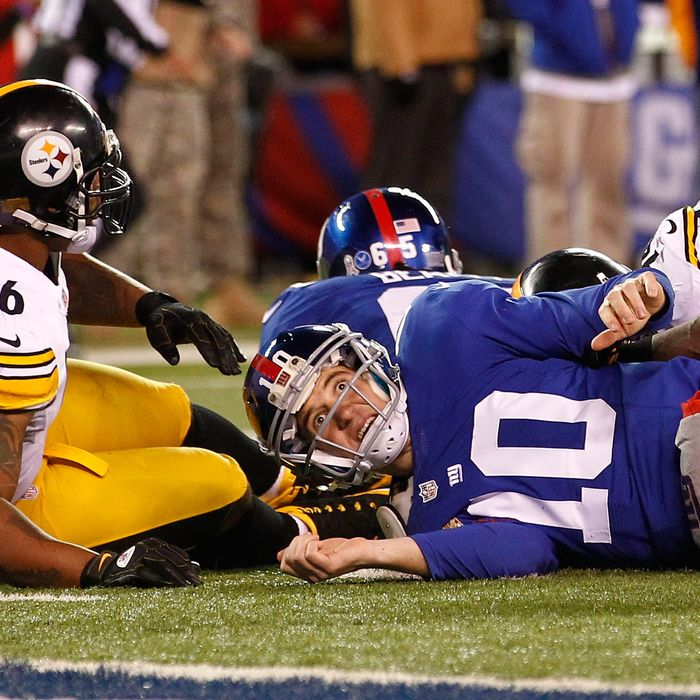 Eli Manning #10 of the New York Giants looks for a call after being taken down by LaMarr Woodley #56 of the Pittsburgh Steelers during their game at MetLife Stadium on November 4, 2012 in East Rutherford, New Jersey.