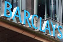 """LONDON, ENGLAND - JUNE 28:  Two people look out from the Canary Wharf headquarters of Barclays Bank, who have been fined 290 million GBP for manipulating the Libor inter-bank lending rate, on June 28, 2012 in London, England. British Prime Minister David Cameron has said the bank's management has """"serious questions"""" to answer regarding their practices. Shares in Barclays have fallen 15% this morning.  (Photo by Oli Scarff/Getty Images)"""
