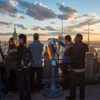 Rockefeller Center vantage point full of tourists at sunset