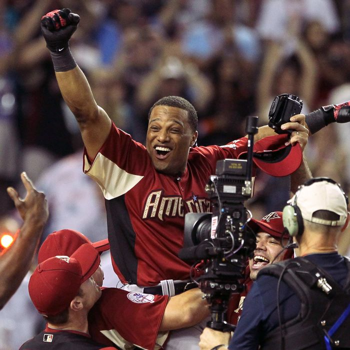 PHOENIX, AZ - JULY 11: American League All-Star Robinson Cano #24 of the New York Yankees reacts after winning the 2011 State Farm Home Run Derby at Chase Field on July 11, 2011 in Phoenix, Arizona. Cano won the 2011 State Farm Home Run Derby with a recond 12 home runs in the final round. (Photo by Jeff Gross/Getty Images)