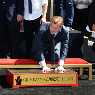 HOLLYWOOD, CA - JULY 07: Director, Writer, Producer Christopher Nolan, who was honored with Hand and Footprint Ceremony at Grauman's Chinese Theatre watched on by on July 7, 2012 in Hollywood, California. (Photo by Frazer Harrison/Getty Images)