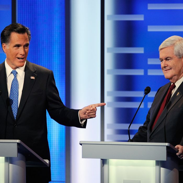 DES MOINES, IA - DECEMBER 10: Former Massachusetts Gov. Mitt Romney points to former speaker of the House Newt Gingrich as he speaks speak at the ABC News GOP Presidential Debate on the campus of Drake University on December 10, 2011 in Des Moines, Iowa. Rivals were expected to target front runner Gingrich in the debate hosted by ABC News, Yahoo News, WOI-TV, The Des Moines Register and the Iowa GOP. (Photo by Kevork Djansezian/Getty Images)