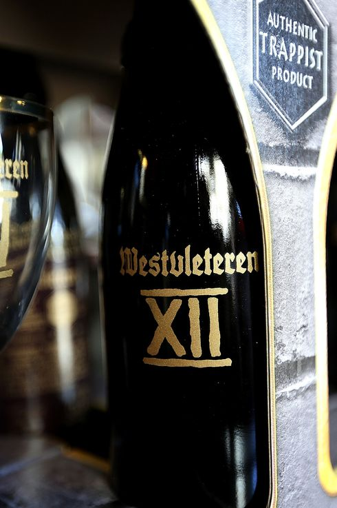 A six-pack of Westvleteren 12 is displayed at Ales Unlimited on December 12, 2012 in San Francisco, California.  Beer connoisseurs across the United States lined up to buy a limited distribution of Westvleteren 12, a beer brewed by Belgian monks at St. Sixtus Abbey. The beer is being exported for the first time to raise funds to replace the roof at St. Sixtus Abbey. The limited number of six-packs are retailing for $84.99 at select stores.