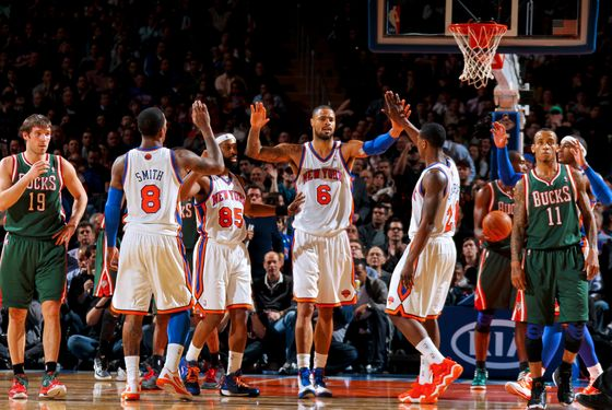 NEW YORK, NY - MARCH 26:  Tyson Chandler #6 of the New York Knicks celebrates with teammates J.R. Smith #8, Baron Davis #85, and Iman Shumpert #21 during a game against the Milwaukee Bucks on March 26, 2012 at Madison Square Garden in New York City.  NOTE TO USER: User expressly acknowledges and agrees that, by downloading and or using this photograph, User is consenting to the terms and conditions of the Getty Images License Agreement. Mandatory Copyright Notice: Copyright 2012 NBAE  (Photo by Nathaniel S. Butler/NBAE via Getty Images)