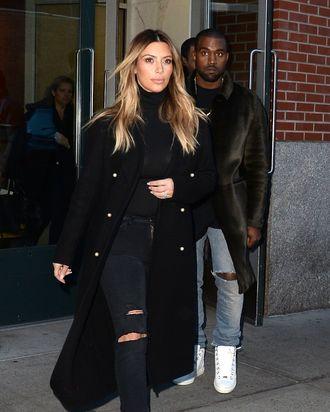 NEW YORK, NY - NOVEMBER 25: Kim Kardashian and Kayne West are seen in Soho on November 25, 2013 in New York City. (Photo by Raymond Hall/FilmMagic)