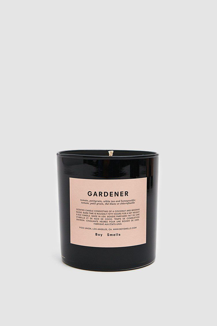 Boy Smells Scented Candle in Gardener