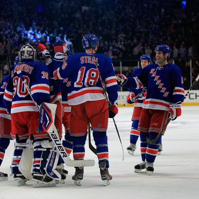 Henrik Lundqvist #30 of the New York Rangers is congratulated for his game winning save against Shane Doan #19 of the Phoenix Coyotes in a penalty shoot out at Madison Square Garden on January 10, 2012 in New York City.