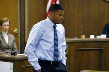 FILE-In this Sunday, March 17, 2013 file photo shows Ma'Lik Richmond walking towards the victim and her family to apologize after he and co-defendant Trent Mays were found delinquent on rape and other charges in Steubenville, Ohio.  Richmond received the state's second-toughest classification from Judge Thomas Lipps,  meaning he has to register as a sex offender every six months for 20 years.   Brooke Burns, the public defender handling the appeal, said Thursday, Sept. 19, 2013,  she couldn't comment without Richmond's permission. The appeal was filed last week in Jefferson County in eastern Ohio..  (AP Photo/Keith Srakocic, File)