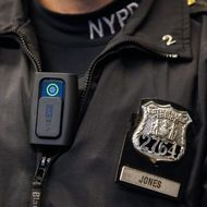 A police body camera is seen on an officer during a news conference on the pilot program involving 60 NYPD officers dubbed 'Big Brother' at the NYPD police academy in the Queens borough of New York, December 3, 2014.