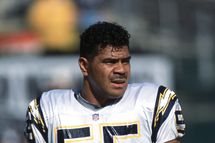 Outside Line Backer Junior Seau #55 of the San Diego Chargers looking on during the game against the Oakland Raiders at the Network Associates Coliseum in Oakland, California. The Raiders defeated the Chargers 35-28.