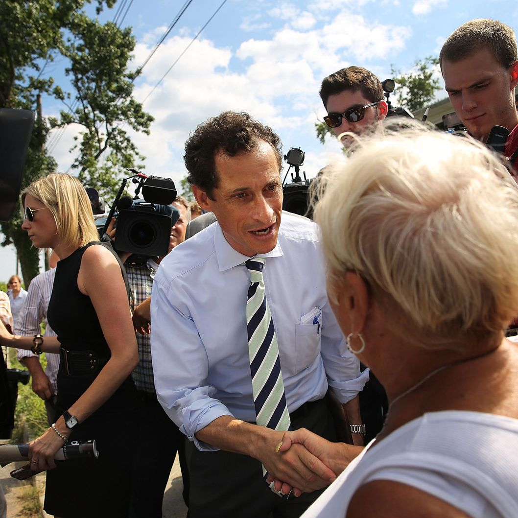 Anthony Weiner, a leading candidate for New York City mayor, speaks with residents in Staten Island on a visit to homes damaged by Hurricane Sandy on July 26, 2013 in New York City. It was recently revealed that Weiner engaged in lewd online conversations with a woman after he resigned from Congress for similar previous incidents.