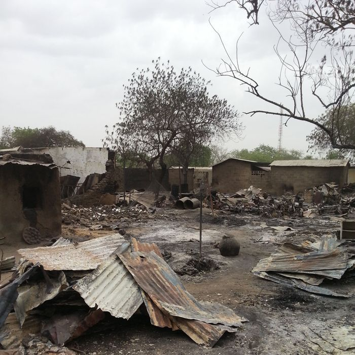 FILE - In this Sunday April. 21, 2013 file photo taken with a mobile phone, the ruins of burnt out houses stand in Baga village in Nigeria. Hundreds of bodies — too many to count — remain strewn in the bush in Nigeria from an Islamic extremist attack that Amnesty International suggested Friday is the