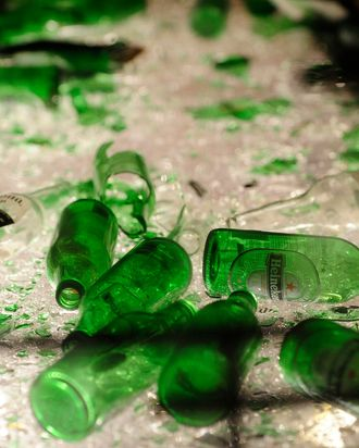 Broken beer bottles sit in a cage after participants took part in