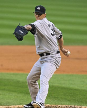 CHICAGO, IL - AUGUST 03: Starting pitcher A.J. Burnett #34 of the New York Yankees delivers the ball against the Chicago White Sox at U.S. Cellular Field on August 3, 2011 in Chicago, Illinois. (Photo by Jonathan Daniel/Getty Images)