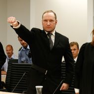 Self confessed mass murderer Anders Behring Breivik raises his fist in a right wing salute on arrival court room 250 at Oslo central court on August 24, 2012 to be sentenced for his twin attacks last year that left 77 people dead, bringing to a close one of the most spectacular trials in Norway's history. Breivik has admitted killing 77 people in the attacks that traumatised Norway and shocked the world, claiming eight victims in an Oslo blast and taking 69 more lives, mostly teenagers', in a shooting frenzy at an island summer camp.