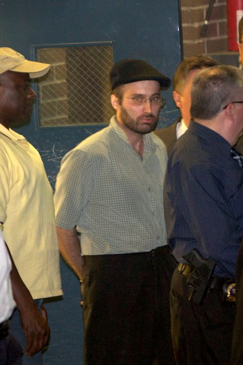 Suspect Levi Aron (man in black cap) was removed to Brooklyn Central Booking fornd Pictures
