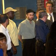 Suspect Levi Aron (man in black cap) was removed to Brooklyn Central Booking for the murder of 9 year old boy Leiby Kretzy in Brooklyn, NY on July 13th. <P> Pictured: Levi Aron <P> <B>Ref: SPL297802  140711  </B><BR/> Picture by: Gary Miller/Splash News<BR/> </P><P> <B>Splash News and Pictures</B><BR/> Los Angeles:310-821-2666<BR/> New York:212-619-2666<BR/> London:870-934-2666<BR/> photodesk@splashnews.com<BR/> </P>