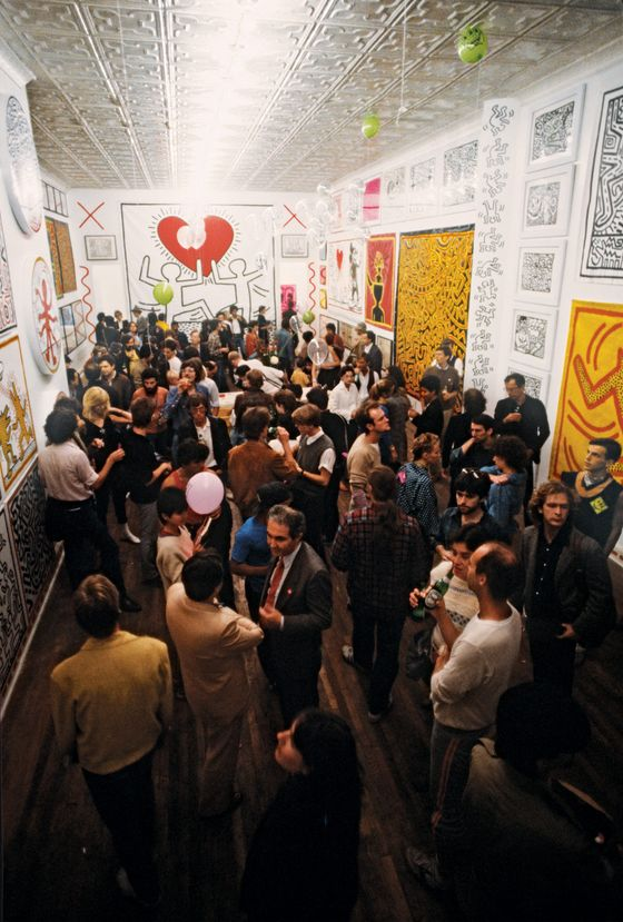 "October 9, 1982 - New York, New York, United States: Keith Haring solo exhibition opens at Tony Shafrazi Gallery in SoHo. Tony Shafrazi is pictured bottom center. Haring (May 4, 1958 ? February 16, 1990) was an artist and social activist whose work responded to the New York City street culture of the 1980s. By expressing concepts of birth, death, sex and war, Haring's imagery has become a widely recognized visual language of the 20th century. The MusÈe d?Art Moderne de la Ville de Paris, in association with Le CENTQUATRE, is devoting a wide-ranging retrospective to Haring in order bear witness to the importance of his work, in particular its profoundly ""political"" content. Almost 250 pictures on canvas and tarpaulins and from subway walls, as well as twenty monumental works, will be exhibited at Le CENTQUATRE, making this one of the largest presentations of Haring?s works ever. (Allan Tannenbaum/Polaris) ///"