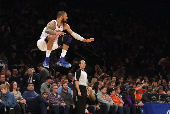 Tyson Chandler #6 of the New York Knicks stretches his legs prior to the game against the Phoenix Suns at Madison Square Garden on December 2, 2012 in New York City.