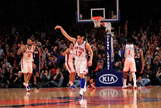 NEW YORK, NY - FEBRUARY 22: Jeremy Lin #17 of the New York Knicks reacts after scoring a three-pointer against the Atlanta Hawks at Madison Square Garden on February 22, 2012 in New York City. NOTE TO USER: User expressly acknowledges and agrees that, by downloading and/or using this Photograph, user is consenting to the terms and conditions of the Getty Images License Agreement.  (Photo by Chris Trotman/Getty Images)