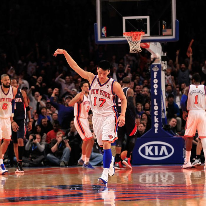 Jeremy Lin #17 of the New York Knicks reacts after scoring a three-pointer against the Atlanta Hawks at Madison Square Garden on February 22, 2012 in New York City.