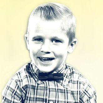 1950s smiling blond boy wearing plaid shirt bow ties looking at camera