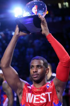 Chris Paul #3 of the Los Angeles Clippers and the Western Conference celebrates after winning MVP in the 2013 NBA All-Star game at the Toyota Center on February 17, 2013 in Houston.