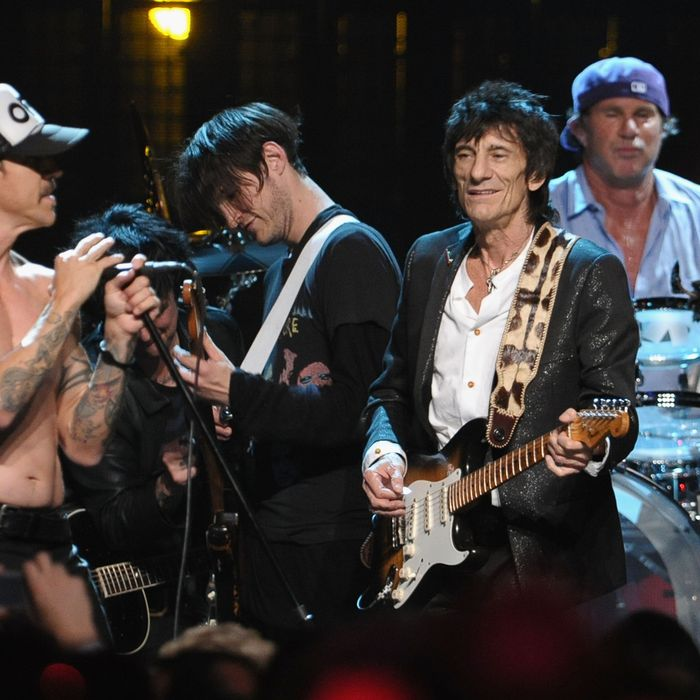 CLEVELAND, OH - APRIL 14: (L-R) Inductees Anthony Kiedis, Josh Klinghoffer, Ron Wood and Chad Smith Josh Klinghofferonstage during the 27th Annual Rock And Roll Hall of Fame Induction Ceremony at Public Hall on April 14, 2012 in Cleveland, Ohio. (Photo by Michael Loccisano/Getty Images)
