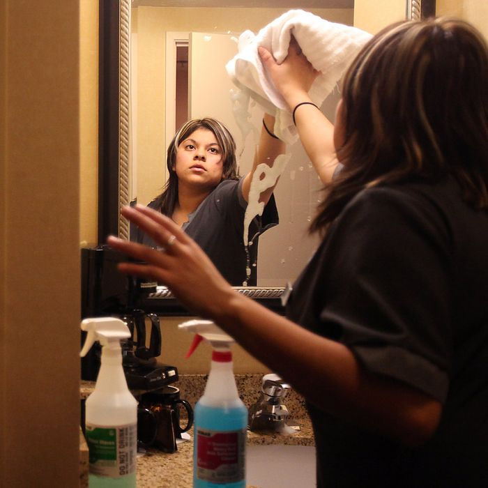 Dec. 14, 2010 - Santa Rosa, CA, USA - Housekeeper Angela Alvarez cleans a room in the Courtyard by Marriott in Santa Rosa on Tuesday, December 14, 2010. (Credit Image: ? Santa Rosa Press Democrat/ZUMAPRESS.com)