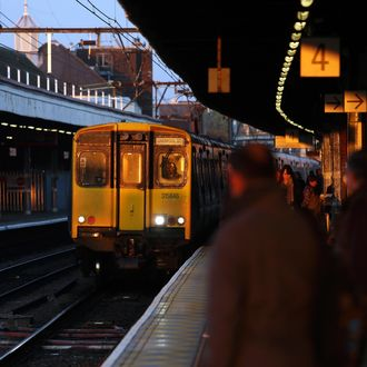 Rail Commuters As U.K. Government Caps Train Fare Increases