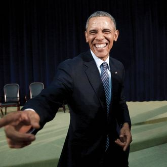 U.S. President Barack Obama reacts while greeting members of the audience after speaking at the Chief of Missions Conference at the State Department in Washington