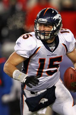 FOXBORO, MA - JANUARY 14:  Tim Tebow #15 of the Denver Broncos looks to pass against the New England Patriots during their AFC Divisional Playoff Game at Gillette Stadium on January 14, 2012 in Foxboro, Massachusetts.  (Photo by Al Bello/Getty Images) *** Local Caption *** Tim Tebow