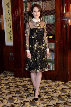 "Michelle Dockery attends a photocall for ""Non-Stop"" at China Tang at The Dorchester on January 30, 2014 in London, England."