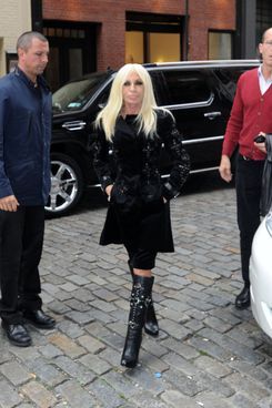 Donatella Versace stops by her new store Versace SoHo in New York City. The store opens this week and is located on Mercer Street in the heart of SoHo shopping distract. Donatella arrived with a security guard as she visited her new store