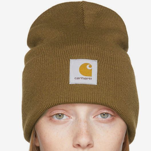 A ribbed Carhartt Work In Progress Brown Watch Beanie with the Carhartt logo patch on a model. 48 Things on Sale You'll Actually Want to Buy: From Sunday Riley to Patagonia - The Strategist