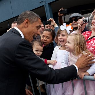 In this handout provided by the White House, President Barack Obama greets children upon arrival September 25, 2011 in Seattle, Washington.